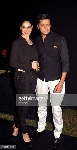 Indian Bollywood actor Riteish Deshmukh poses with his wife actress Genelia D'Souza as they arrive to attend a party hosted by actress Deepika...