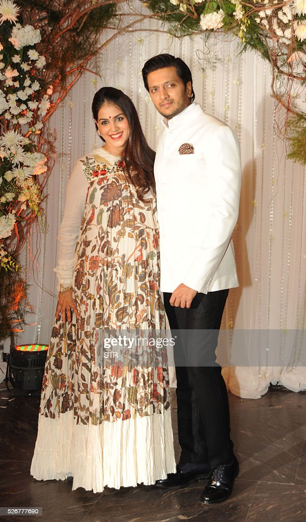 Indian Bollywood actor Riteish Deshmukh(R)poses with his wife ...