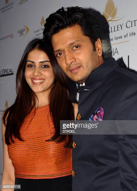 Indian Bollywood actor Ritesh Deshmukh is photographed with his wife Genelia DSouza as they attend the Aamby Valley India Bridal Fashion Week 2013 in...