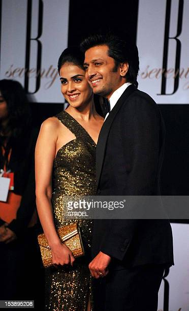 Indian Bollywood actor Ritesh Deshmukh poses with his wife actress Genelia D'Souza as they attend the 70th Birthday celebrations of Bollywood Actor...