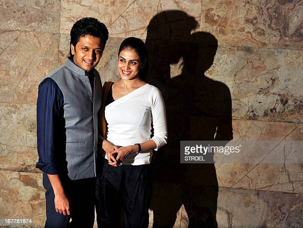 """Indian Bollywood actor Ritesh Deshmukh poses with his wife actress Genelia D'Souza during a special screening of the forthcoming film """"Bombay..."""