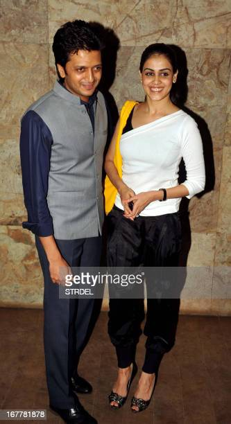 "Indian Bollywood actor Ritesh Deshmukh poses with his wife actress Genelia D'Souza during a special screening of the forthcoming film ""Bombay..."