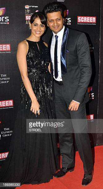 Indian Bollywood actor Ritesh Deshmukh with wife Genelia Dsouza during the 19th annual Colors Screen Awards in Mumbai on January 12 2013 AFP PHOTO