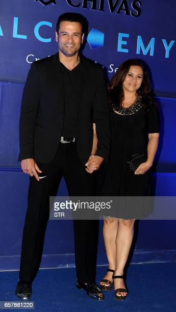 Indian Bollywood actor Rohit Roy with his wife Manasi Joshi pose as they attend a Chivas 18 Alchemy promotional event in Mumbai on March 25 2017...
