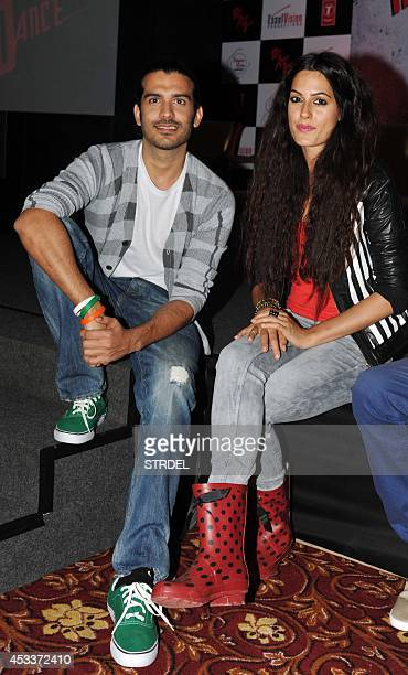 Indian Bollywood actor Saahil Prem and actress Amrit Maghera pose at the unveiling of the application 'The MAD Wall of Dreams' specially created for...