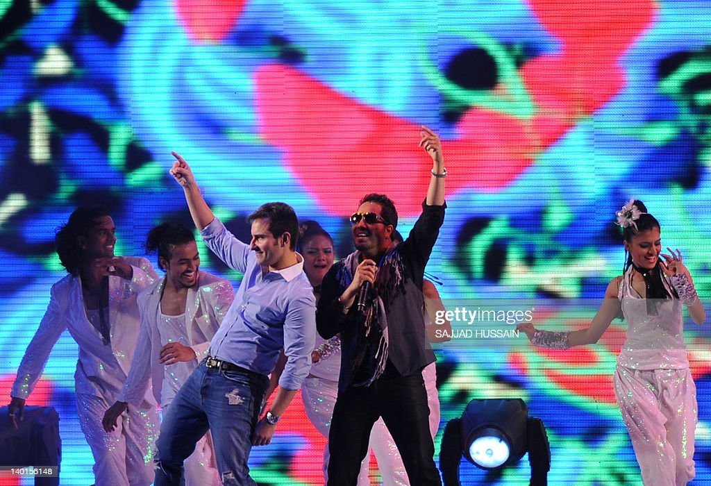 Indian Bollywood actor Saif Ali Khan and Bollywood singer Mikka Singh perform during the opening ceremony of the world series field hockey tournament.
