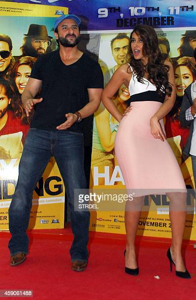 Indian Bollywood actor Saif Ali Khan and Ileana DCruz pose during the promotion of their Hindi film Happy Ending in Mumbai late November 15 2014 AFP...