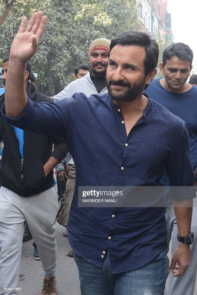 Indian Bollywood actor Saif Ali Khan gestures during filming on the set of the forthcoming Hindi film `Chef` directed by Raja Krishna Menon in...