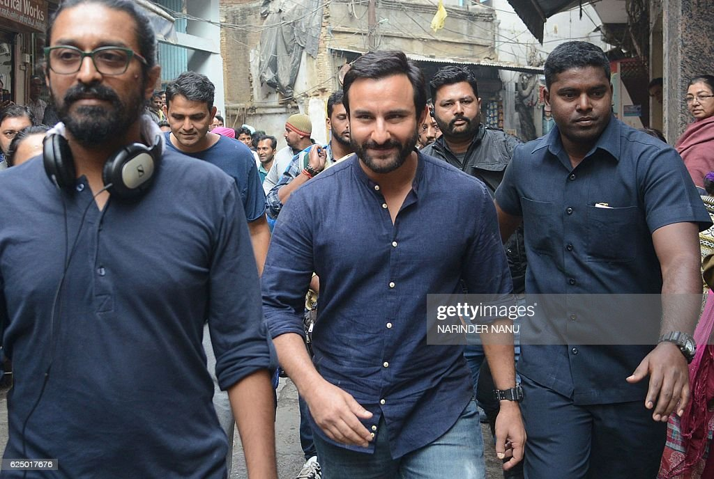 Indian Bollywood actor Saif Ali Khan walks along a street during filming on the set of the forthcoming Hindi film `Chef` directed by Raja Krishna...