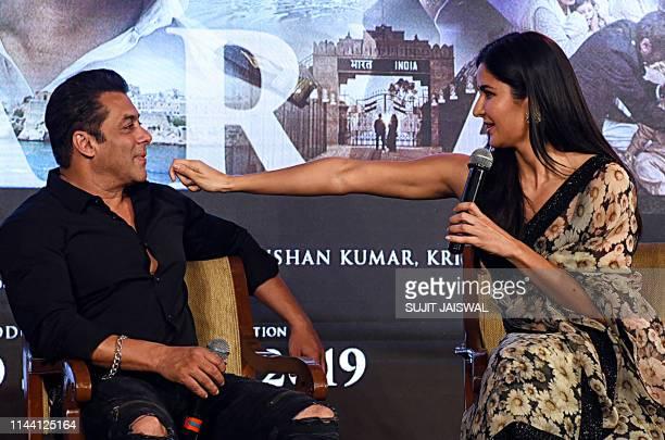 Indian Bollywood actor Salman Khan and actress Katrina Kaif interact with eachother during the launch of their upcoming Hindi film 'Bharat' in Mumbai...