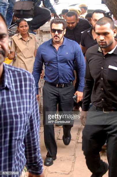 Indian Bollywood actor Salman Khan arrives to appear before a court district judge in connection with an Arms Act case in Jodhpur on August 4 2017 /...