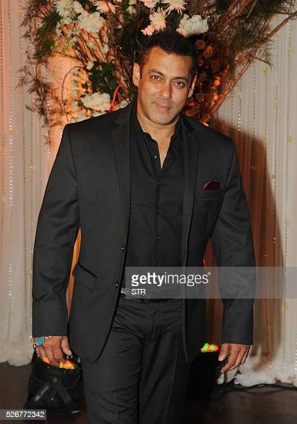 Indian Bollywood actor Salman Khan poses as he attends a reception after the wedding of fellow thespians Bipasha Basu and Karan Singh Grover in...