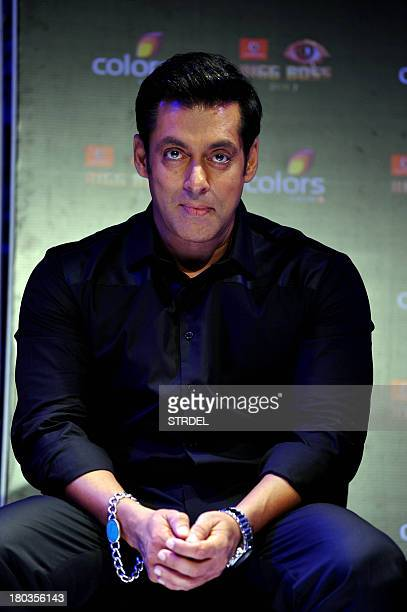 Indian Bollywood actor Salman Khan poses for a photo during a press conference for the reality game show BIGG BOSS Season 7 in Mumbai on September 11...
