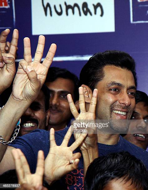 Indian Bollywood actor Salman Khan poses for a photograph alongside disabled children during the launch of a campaign for his 'Being Human'...