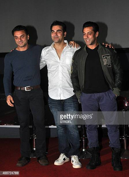 Indian Bollywood actor Salman Khan poses with his brothers Arbaaz and Sohail during the preview trailer for the forthcoming Hindi film Jai Ho in...