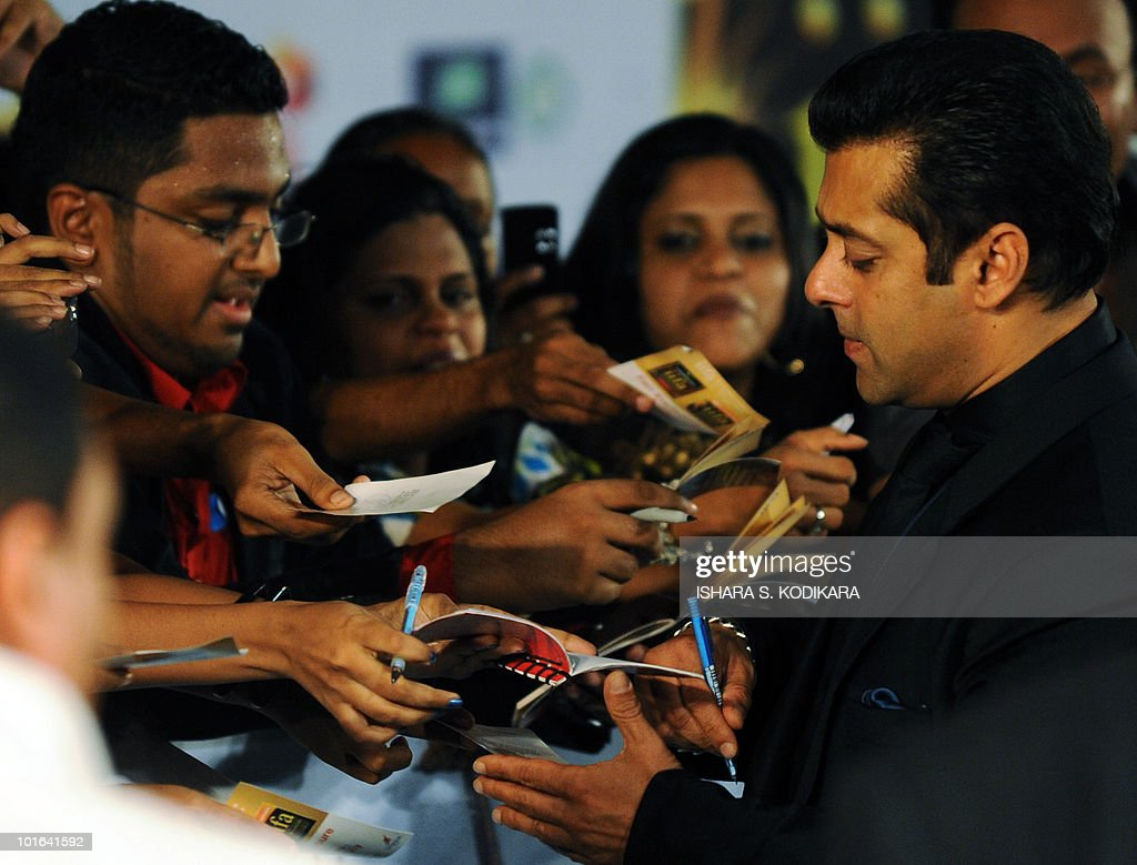 Indian Bollywood actor Salman Khan signs autographs for fans at the International Indian Film Academy (IIFA) awards in Colombo on June 5, 2010. Bollywood actors arrived in Sri Lanka to attend the three-day International Indian Film Academy (IIFA) awards and surrounding events that begun in Colombo on June 3. AFP PHOTO/Ishara S. KODIKARA