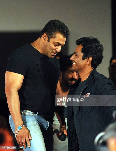 Indian Bollywood actor Salman Khan speaks with Nawazuddin Siddiqui during the trailer launch of the forthcoming Hindi film Bajrangi Bhaijaan directed...