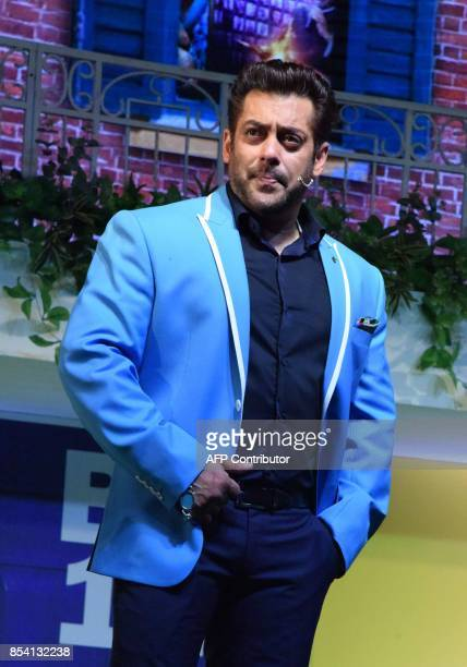 Indian Bollywood actor Salman Khan stands on stage during a launch event for the upcoming 11th edition of the televison reality show 'Big Boss'...