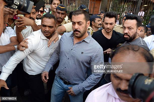 Indian Bollywood actor Salman Khan walks from Bombay High Court in Mumbai on December 10 after being acquitted of culpable homicide The court cleared...