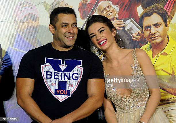 Indian Bollywood actor Salman Khanposes with British actress Amy Jackson during the trailer launch of their home production Hindi film 'Freaky Ali in...
