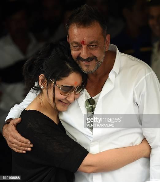 Indian Bollywood actor Sanjay Dutt hugs his wife Manyata ...