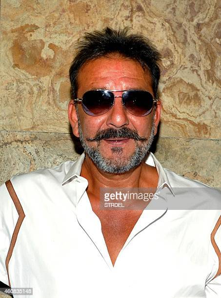 Indian Bollywood actor Sanjay Dutt on two weeks furlough from his prison sentence attends a special screening of his Hindi film 'PK' in Mumbai on...