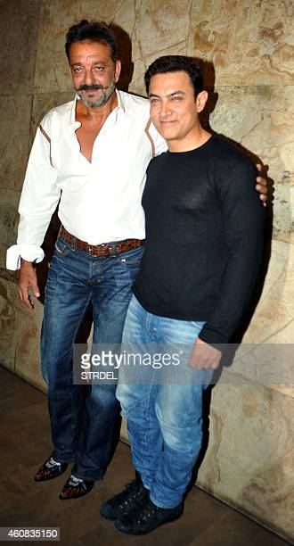 Indian Bollywood actor Sanjay Dutt on two weeks furlough from his prison sentence poses with actor Aamir Khan as they attend a special screening of...