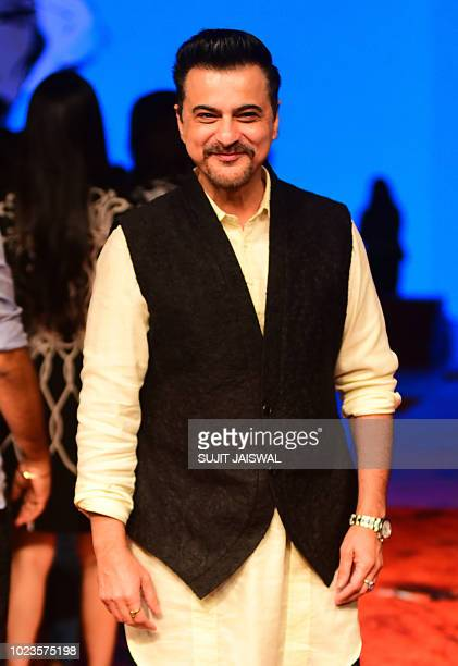 Indian Bollywood actor Sanjay Kapoor poses for a photograph during at Lakmé Fashion Week Winter/Festive 2018 in Mumbai late on August 25 2018