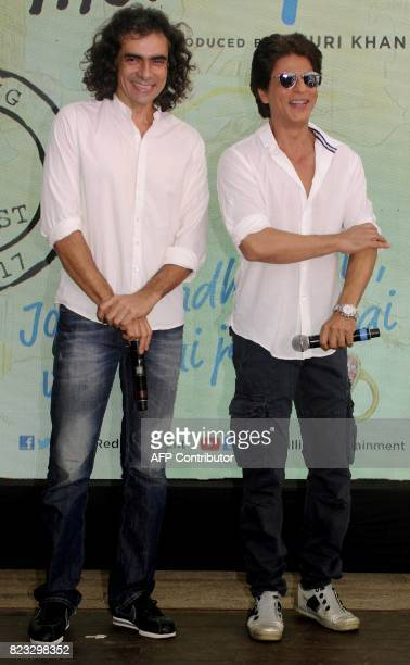 Indian Bollywood actor Shah Rukh Khan and film director Imtiaz Ali pose for a photograph during a promotional event for the forthcoming Hindi film...