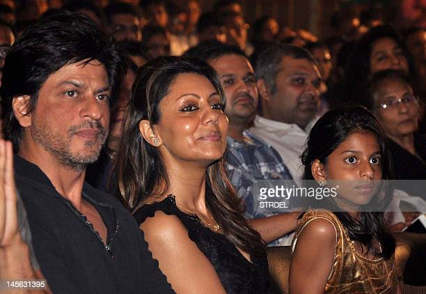 Indian Bollywood actor Shah Rukh Khan and his wife Gauri and Suhana their daughter watch Shiamak Davar's Summer Funk 2012 dance during the screening...