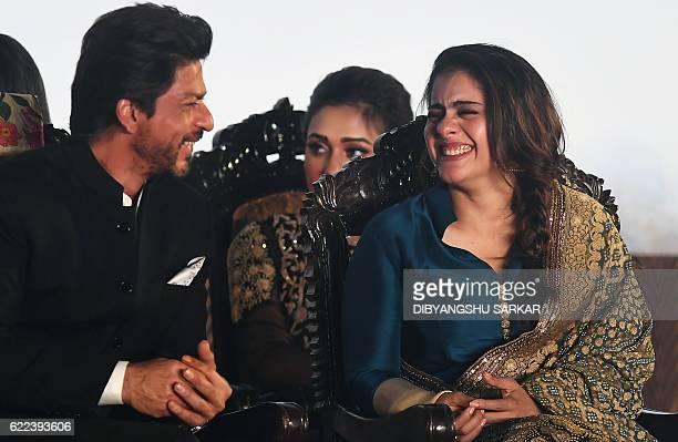 Indian Bollywood actor Shah Rukh Khan and Kajol attend the inauguration of the 22st Kolkata International Film Festival in Kolkata on November 11...