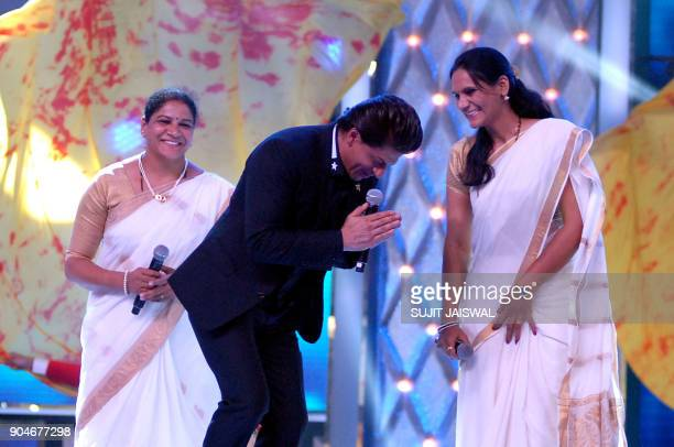 Indian Bollywood actor Shah Rukh Khan and personnel from the Mumbai police take part in the'Umang Mumbai Police Show 2018' in Mumbai on late January...