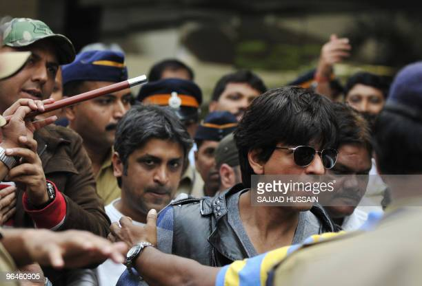 Indian Bollywood actor Shah Rukh Khan arrives from the US at Mumbai's city airport on Feburary 6 2010 Indian rightwing Shiv Sena party chief Bal...
