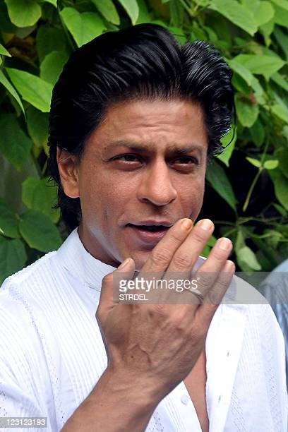 Indian Bollywood actor Shah Rukh Khan gestures at his residence during Eid alFitr in Mumbai on August 31 2011 AFP PHOTO/STR
