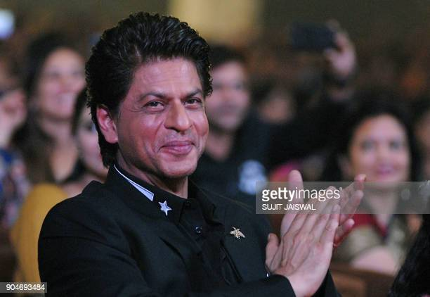 Indian Bollywood actor Shah Rukh Khan looks on during the 'Umang Mumbai Police Show 2018' in Mumbai on late January 13 2018 / AFP PHOTO / Sujit...