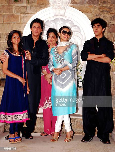 Indian Bollywood actor Shah Rukh Khan pictured with his family daughter Suhana sister Shehnaz wife Gauri Khan and son Aryan Khan pose during an event...
