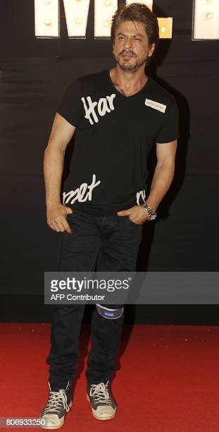 Indian Bollywood actor Shah Rukh Khan poses for a photograph during a promotional event for the forthcoming Hindi film 'Jab Harry Met Sejal' written...