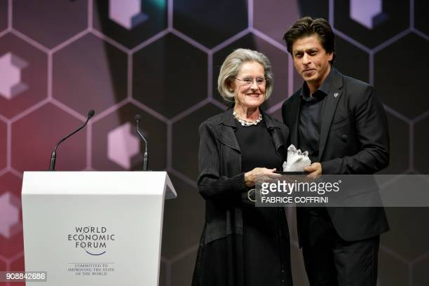 Indian Bollywood actor Shah Rukh Khan receives a Crystal Award from the hands of Schwab Foundation for Social Entrepreneurship Chairperson and...