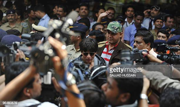 Indian Bollywood actor Shah Rukh Khan speaks with media as he arrives from the US at Mumbai's city airport on Feburary 6 2010 Indian rightwing Shiv...