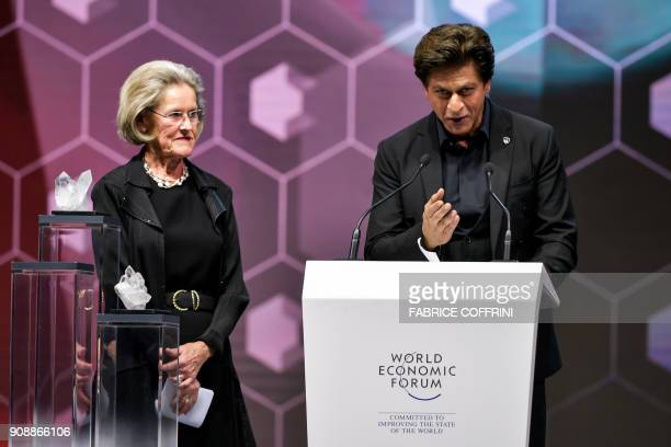 Indian Bollywood actor Shah Rukh Khan thanks the assembly as he stands next to Schwab Foundation for Social Entrepreneurship Chairperson and...