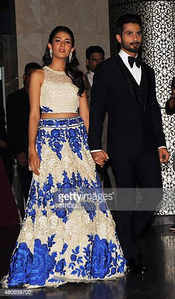 Indian Bollywood actor Shahid Kapoor and his wife Mira Rajput arrive for their wedding reception in Mumbai on July 12 2015 AFP PHOTO / STR