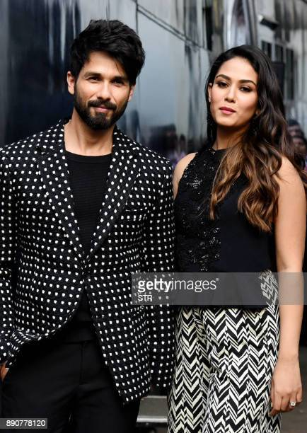 Indian Bollywood actor Shahid Kapoor and his wife Mira Rajput pose for a photograph during a promotional event in Mumbai on December 11 2017 / AFP...