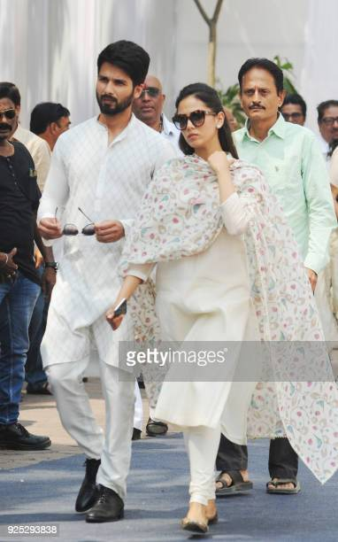 Indian Bollywood actor Shahid Kapoor attends with his wife Mira Rajput the funeral of legendary late Bollywood actress Sridevi Kapoor in Mumbai on...