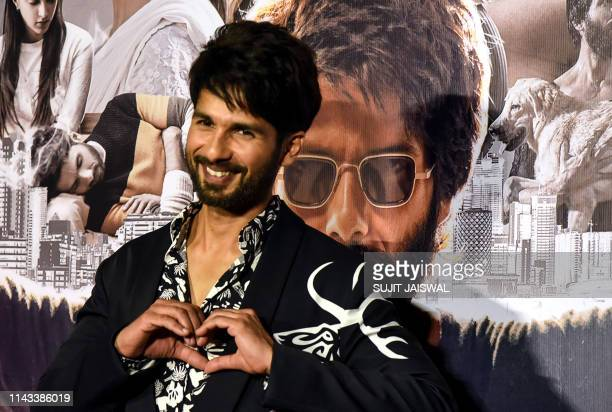 Indian Bollywood actor Shahid Kapoor gestures as he poses for photographs during the trailer launch of the upcoming Hindi film 'Kabir Singh' in...
