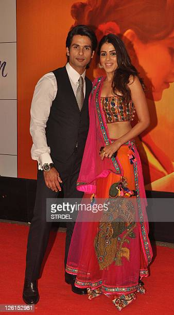 Indian Bollywood actor Shahid Kapoor poses with actress Genelia D'Souza as they attend the premiere for the Hindi film Mausam in Mumbai late...