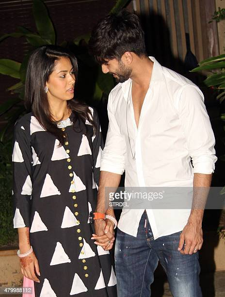 Indian Bollywood actor Shahid Kapoor poses with his wife Mira Rajput at their residence in Mumbai late July 8 2015 AFP PHOTO/STR