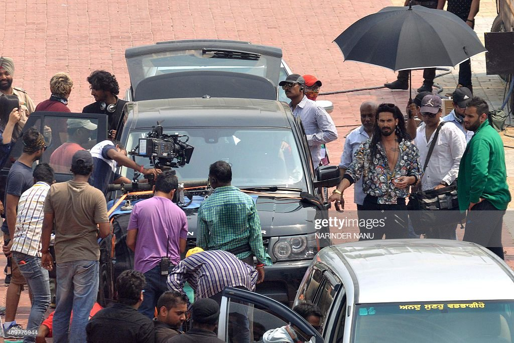 Indian Bollywood actor Shahid Kapoor walks with film crew during the shooting of his new film `Udta Punjab` which is based on the drug problem in the.
