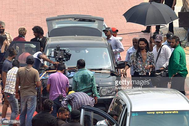 Indian Bollywood actor Shahid Kapoor walks with film crew during the shooting of his new film 'Udta Punjab' which is based on the drug problem in the...