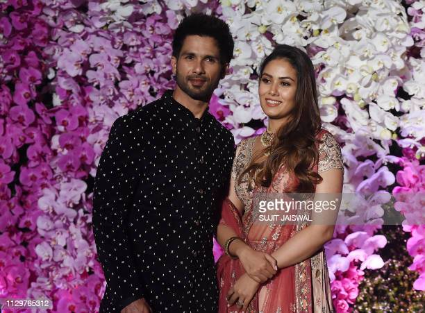 Indian Bollywood actor Shahid Kapoor with his wife Meera Rajput arrive to attend the wedding reception of Akash Ambani son of Indian businessman...