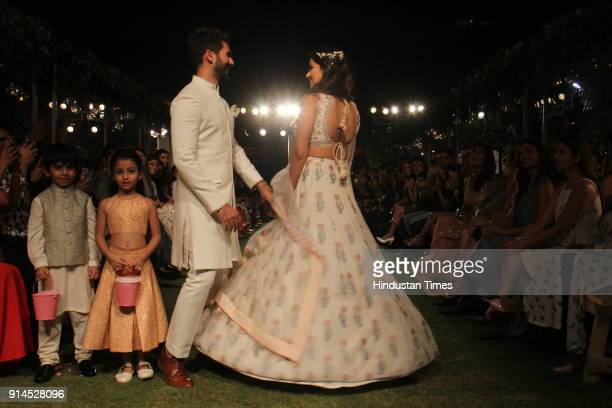 Indian Bollywood actor Shahid Kapoor with his wife Mira Rajput showcase a creation by designer Anita Dongre at the Lakmé Fashion Week Summer Resort...